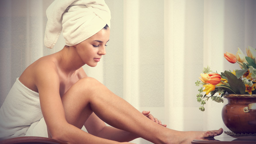 pretty-female-taking-care-of-her-legs-after-bath.jpg
